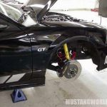 Let's move inside the shop. Here is a 2000 GT getting the Saleen magic touch.