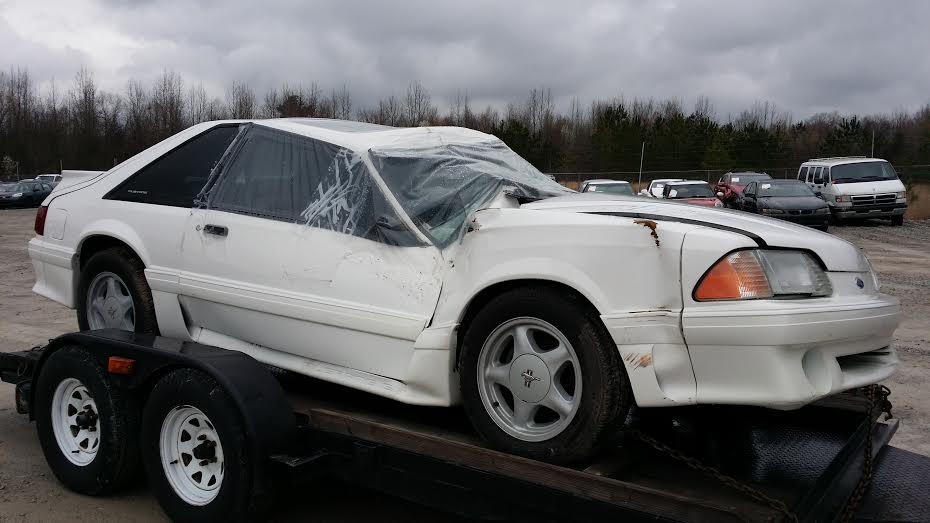 Donor Mustang GT hatch in white w/ black interior and 80,000 original miles.