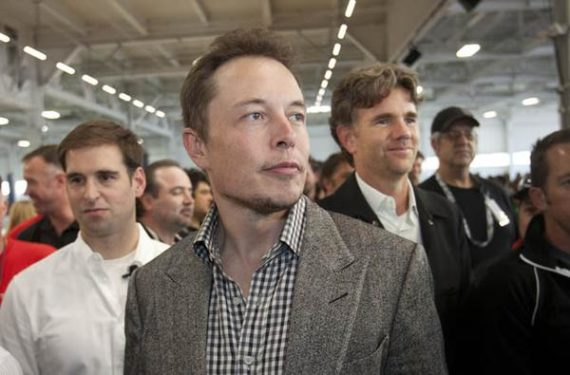CEO Elon Musk, center, with CTO J.B. Straubel, left, and Chief Designer Franz von Holzhausen watch as Tesla launched the Model S, at their factory in Fremont, Calif., on Friday, June 22, 2012. The event marked the start of its Fremont assembly line and, the company hopes, eventual entry into the mass market with its revolutionary electric car. (Patrick Tehan/Staff)
